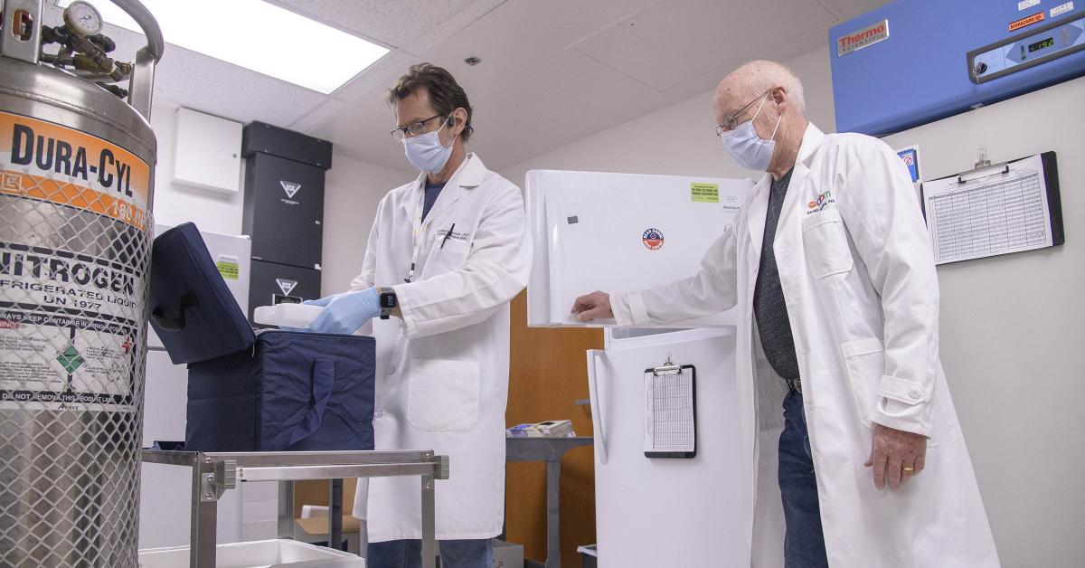 """David Harris, PhD, executive director of the UArizona Health Sciences Biorepository (right), and Michael Badowski, PhD, associate research scientist in the Division of the Translational and Regenerative Medicine in the Department of Medicine at the College of Medicine – Tucson (left), are tasked with monitoring the """"freezer farm."""""""