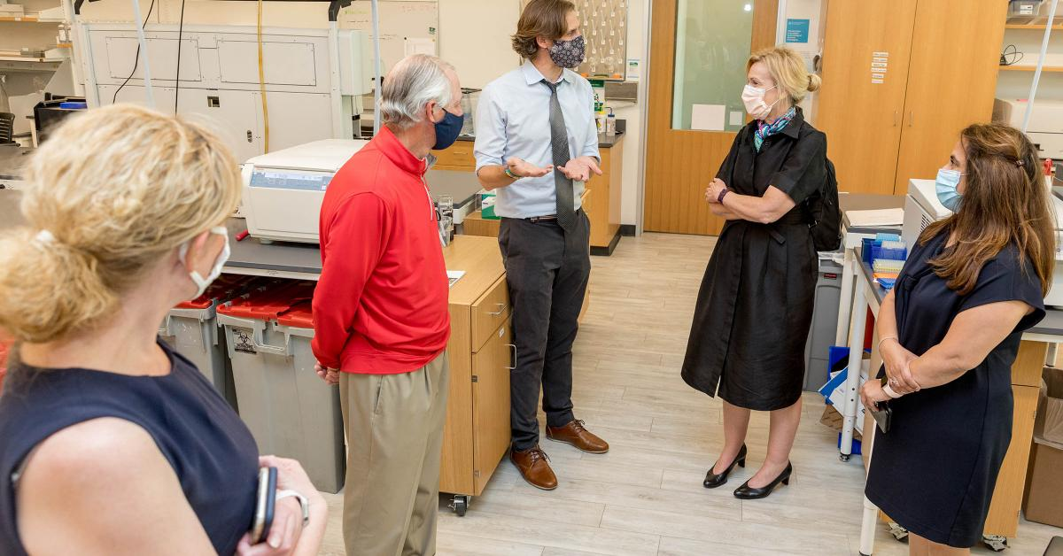 Deborah Birx, MD, coordinator of the White House Coronavirus Task Force, visited University of Arizona and UArizona Health Sciences laboratories where researchers are testing antibody and antigen samples collected from students and employees. Ryan Sprissler, PhD, staff scientist and manager of the UArizona Genetics Core, speaks with Dr. Birx as UArizona President Robert C. Robbins, MD, and others, listen.