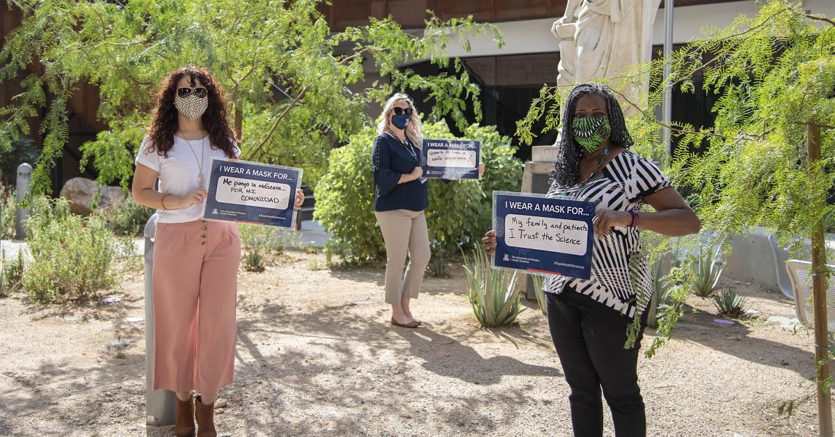 A showing of support for public health protocols from the College of Medicine – Tucson's Office of Diversity, Equity and Inclusion. From left: Michelle Ortiz, PhD, Rachelle Powell, Victoria Murrain, DO.