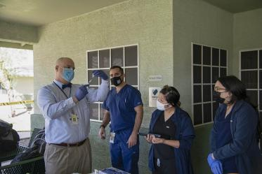 Dr. Jim Lindgren, director of simulation curriculum and clinical assistant professor at College of Medicine in Phoenix, trains medical and pharmacy students to administer the COVID-19 vaccine.