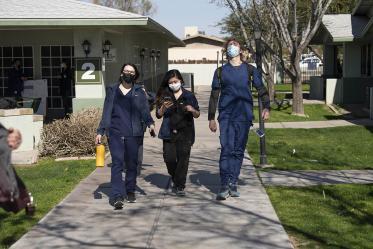 College of Medicine – Phoenix classmates Alexis Montoya, Bernice Alcanzo and Colton Cowan leave El Mirage Senior Housing complex, where they helped implement a pilot COVID-19 vaccine distribution program.