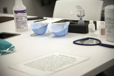 Items on a table used for N95 mask fitting.