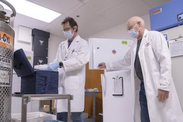 "David Harris, PhD, executive director of the UArizona Health Sciences Biorepository (right), and Michael Badowski, PhD, associate research scientist in the Division of the Translational and Regenerative Medicine in the Department of Medicine at the College of Medicine – Tucson (left), are tasked with monitoring the ""freezer farm."""