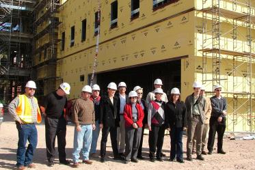 Faculty and staff take their first tour of Roy P. Drachman Hall in 2005, the future home of the Mel and Enid Zuckerman College of Public Health.