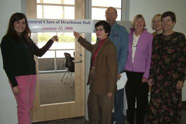 First day of class in Roy P. Drachman Hall, 2006. Jordana Choucair, left, poses with Dean G. Marie Swanson, PhD, MPH; Joel Meister; Jill deZapien; Chris Tisch; Denise Roe, DrPH.
