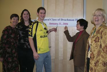 Students and faculty pose for a photo on the first day of class January 11, 2006. Pictured from left: Denise Roe, DrPH; Darlene Lopez; a student; Dean G. Marie Swanson, PhD, MPH; Chris Tisch.