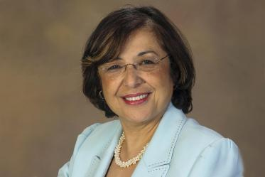 Iman Hakim, MD, PhD, MPH, is the college's dean and a professor.
