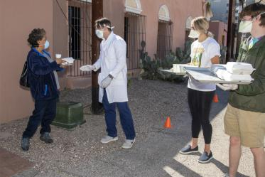 Students in the College of Medicine – Tucson volunteer to provide health care and meals to Tucson's homeless population.