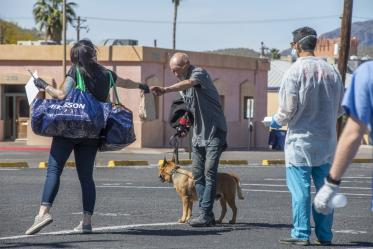 Christian Bergman, left, is a medical student volunteering to serve the homeless population of Tucson with medical services during the worldwide pandemic COVID-19 outbreak.