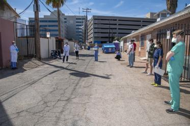 College of Medicine – Tucson students meet downtown before offering health care services to Tucson's vulnerable homeless population amid the COVID-19 pandemic.