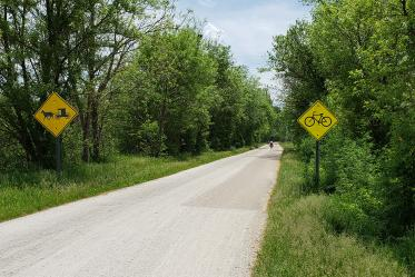A sign marks the trial as suitable for bicycles and horse-drawn buggies in Ohio.
