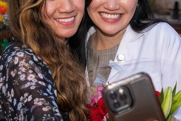 Medical student Bobbie Alcanzo takes a selfie with her sister Bernice Alcanzo after the Class of 2025 white coat ceremony.