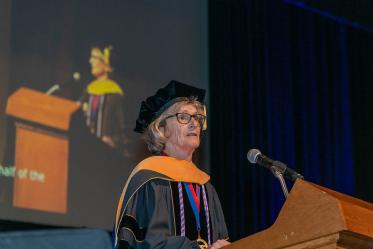 Ki Moore, PhD, RN, FAAN, dean of the College of Nursing, speaks during the commencement ceremony at Centennial Hall.