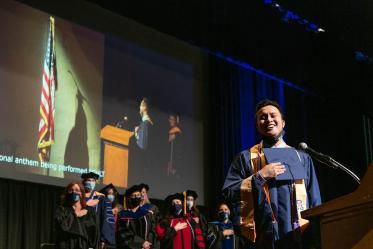 Kevin Vidal sings the National Anthem during the College of Nursing's August commencement at Centennial Hall.