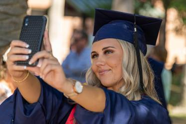 Caitlyn Bolier takes a selfie after her graduation ceremony from the College of Nursing.