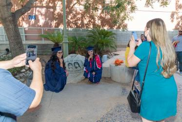 Rita Morado (left) and Valeria Pena-Quijada pose for a photo after the August commencement.