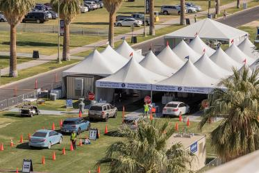 Bird's eye view of the drive-through COVID 19 vaccine point of distribution on the University of Arizona's mall.
