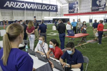 A new use for a practice field, testing is conducted in this climate controlled temporary clinic set up inside the Cole and Jeannie Davis Sports Center.