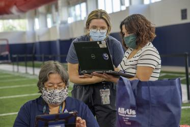 Banner Healthcare workers gather to review charts. The University of Arizona plans to provide antibody blood testing for most of its 45,000 students and 15,000 employees with separate funding.