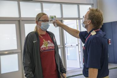 Upon arrival at the testing facility, all individuals are required to wear a mask, and have their temperature checked by health care personnel.