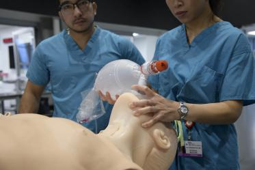 Internal medicine students practice on high-fidelity manikins that can be programmed to simulate a wide range of patients.