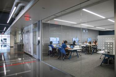 Floors three through six feature classrooms outfitted with technology, and small group working spaces with doors and whiteboards to assist in collaboration efforts.
