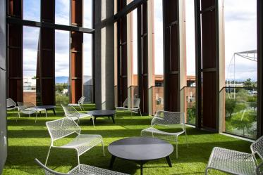 Outdoor spaces on the upper floors of the building offer covered, panoramic views and access to natural elements.