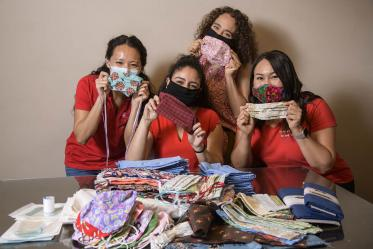 University of Arizona College of Medicine – Tucson students in the Commitment to Underserved People Program held a drive to help the Navajo Nation during the COVID-19 pandemic. Students Lynn Pham, Guadalupe Davila, Nicole Bejany and Thomasina Blackwater hold up face masks they sent to the Navajo Nation.