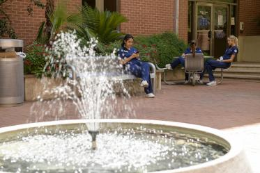 A patch of shade and the sound of running water make the courtyard at the College of Nursing a favorite place for people to get outside, even in the summer.