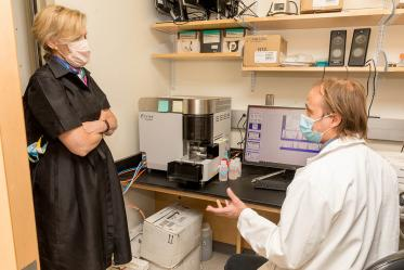 Deborah Birx, MD, coordinator of the White House Coronavirus Task Force, talks with a scientist during a recent tour of laboratories. The tour focused on the labs testing antibody and antigen samples collected from students and employees.