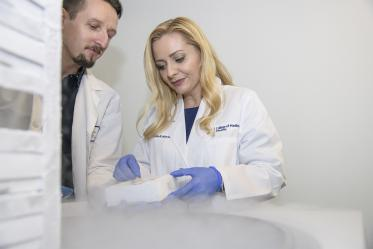 Drs. Herbst-Kralovetz and Łaniewski select cells preserved through cryopreservation, a technique that can freeze cells without damaging them.