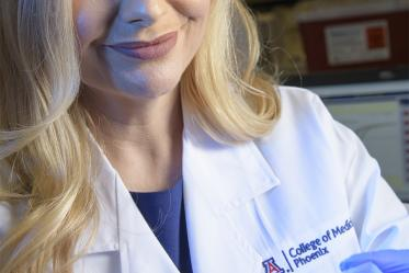 Melissa Herbst-Kralovetz, PhD, with samples that may unlock some clues about vaginal health and gynecologic cancer.