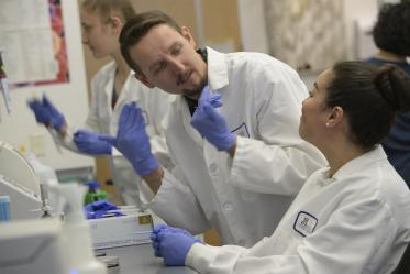 The Herbst-Kralovetz Lab makes its home on the Phoenix Biomedical Campus. Paweł Łaniewski, PhD, center, and Elisa Martinez, right, work to find the link between the vaginal microbiome and gynecologic cancer.