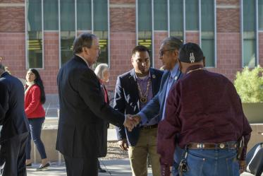 After the blessing, Senior Vice President for the University of Arizona Health Sciences Michael D. Dake, MD, shakes the hand of Ned Norris, chairman of the Tohono O'odham Nation.