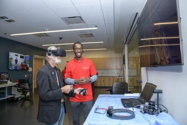 A visitor to the Arizona Simulation Technology and Education Center, or ASTEC, takes a virtual reality tour through the human body.