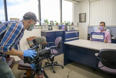Roy Wageman, videographer in the Health Sciences Office of Communications, records Todd Vanderah, PhD, as he talks about the importance of wearing a mask. Vanderah is director of the Health Sciences Comprehensive Pain and Addiction Center.