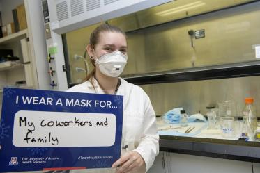 Angela Smith is an undergraduate research fellow studying pain in Todd Vanderah's lab at the College of Medicine – Tucson. Smith wears a mask for her coworkers and family.