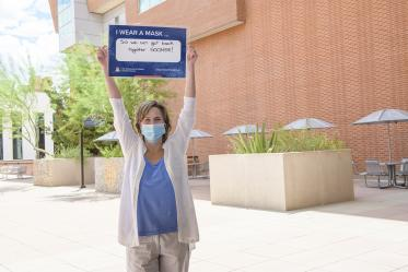 """Kathy W. Smith, MD, is assistant dean of student affairs at the College of Medicine – Tucson. Smith wears a mask """"So we can all get back together sooner rather than later."""""""