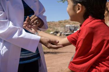 Vanessa Jensen, MD, helps drop off donations for Navajo residents at a community center in Tuba City. The supplies were gathered by University of Arizona College of Medicine – Tucson students who are involved with the Association of Native American Medial students (ANAMS) and the Rural health Professions Program (RHPP).