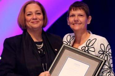 Valerie Jackson, MD, president of the RSNA (left), presents the Outstanding Researcher of 2019 Award to Elizabeth Krupinski, PhD.