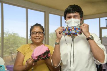 Navajo seamstress Theresa Hatathlie-Delmar and College of Medicine – Tucson student Aaron Bia pose with masks made from donated material.