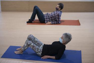 Ron Bachorski and Virginia Belser sit up while practicing a movement exercise.