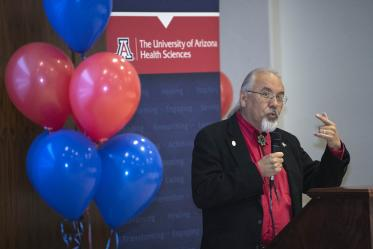 Dr. Carlos Gonzales speaks to attendees during the Tucson Primary Care Physician scholarship reception.