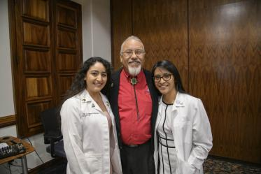 Primary Care Physician scholarship recipients Guadalupe Davila and Cazandra Zaragoza pose for a photo with Dr. Carlos Gonzales at the Tucson scholarship reception.