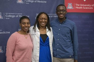 Primary Care Physican scholarship recipient Oumou Bah poses for a photo with her family.