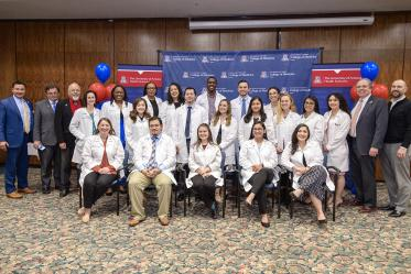 The Tucson Primary Care Physician scholarship recipients, University of Arizona Health Sciences staff and scholarship organizers.