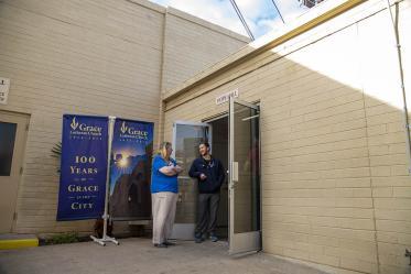 Street Medicine Phoenix co-founder Justin Zeien, right, speaks with a fellow volunteer in front of Grace Lutheran Church.