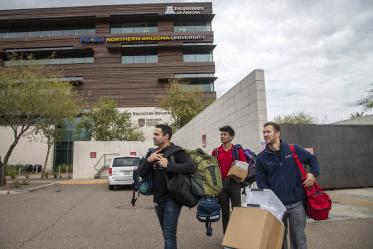 Co-founder Jeffery Hanna, left, student volunteer Eashan Das, center, and co-founder Justin Zeien, right, return supplies to the Street Medicine Phoenix storage area on College of Medicine – Phoenix campus after the Grace Lutheran Church street run.