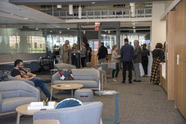 Attendees check out the new space during the grand opening of the Faculty Commons + Advisory event.