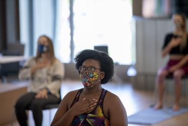 N'Dea Walker practices a breathing technique designed to bring awareness to breath and body and promote mindfulness.